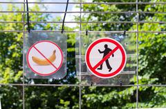 Unrecognizable persons violating the prohibition to walking and trashing. War Stock Photos