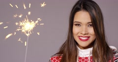 Young woman celebrating Christmas with a sparkler Stock Footage