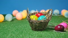 Colorful easter eggs in nest on meadow Stock Footage
