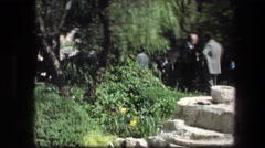 1976: mill grinding stone in a park setting. GARDEN TOMB JERUSALEM ISRAEL Stock Footage