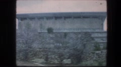 1976: large square like building with many pillars surrounding it. GARDEN TOMB Stock Footage