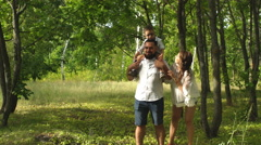 Happy family having fun in the woods Stock Footage