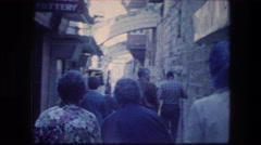 1976: people walking through a small alley. GARDEN TOMB JERUSALEM ISRAEL Stock Footage