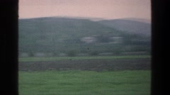 1976: jouncing around while rolling through the lush, green countryside filmed Stock Footage