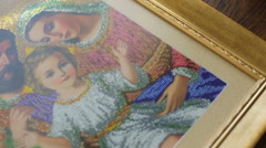 Embroidered picture of holy family Stock Footage