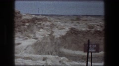 1976: footage of a location near a cave based on a sign filmed by people touring Stock Footage