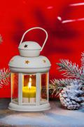 Still life with lantern and Christma tree in the snow Stock Photos