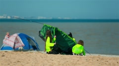 Problems with the installation of tents on the beach Stock Footage