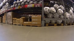 POV Camera on shopping cart moving fast in furniture store between shelves Stock Footage