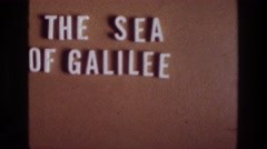 1976: letters spelling 'the sea of galilee' on a plain background SEA OF GALILEE Stock Footage