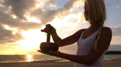 Woman Playing on Singing Zen Bowl at Sunset During Meditation Stock Footage