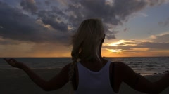 Yogi Woman Meditating and Practicing Yoga on Beach at Sunset Stock Footage