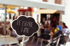 Text leisure time in a signboard Stock Photos