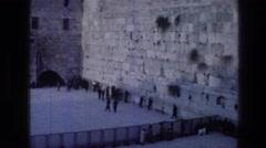 1976: people praying at the wailing wall in jerusalem WAILING WALL JERUSALEM Stock Footage