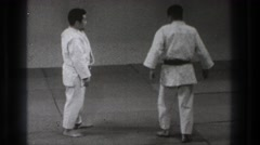 1965: two men taking their stance for a beginning of a fighting match JAPAN Stock Footage