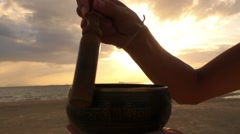 Meditation with Singing Bowl at Beach at Sunset Stock Footage