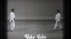 1965: two karate masters study advanced techniques for defensive strategies Stock Footage