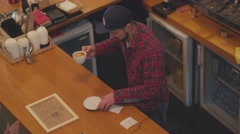 Preparing cups of espresso at a busy coffee shop Stock Footage