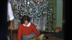1957: woman playing with her animals on christmas morning. WHEELING OHIO Stock Footage