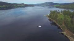 Forward flight above Huon River and Highway, Huon Valley, Tasmania Stock Footage