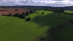 Aerial view of the countryside with a fast moving cloud shadow. Stock Footage
