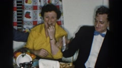 1957: small party gathered and eating around the table WHEELING OHIO Stock Footage