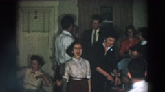 1957: family all gathered together at a family function. WHEELING OHIO Stock Footage