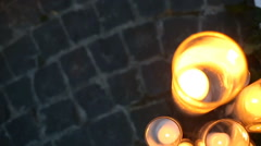 Vases with sparkling candles stand on carriage road Stock Footage