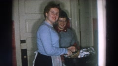 1957: celebrating at home with a large group, young and old WHEELING OHIO Stock Footage