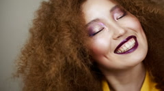Beautiful Asian girl with bright makeup and curly hair smiling happily Stock Footage