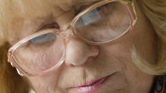Old lady in glasses flipping through the book. Stock Footage