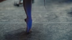 Feet of ballerina in Pointe shoes Stock Footage