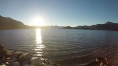 Beautiful waves on fjord with sunshine reflection on surface slow motion Stock Footage