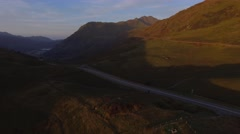 Aerial view over a road in Snowdonia. Stock Footage
