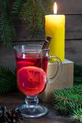 Christmas hot mulled wine and lighted candle Stock Photos