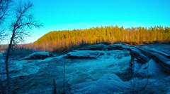 Majestic rapid river waterfall in frosty and cold autumn morning with sunshine Stock Footage