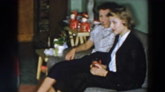 1957: two women sitting and talking on a couch in the living room WHEELING OHIO Stock Footage