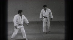 1971: two adult men practice karate techniques TOKYO JAPAN Stock Footage