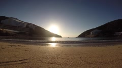 Waves washing up onto Cala Llonga beach. Stock Footage