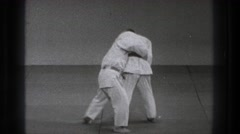 1971: two young men perform karate moves, stand and face each other Stock Footage