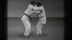 1971: two people demonstrating a karate move. TOKYO JAPAN Stock Footage