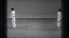 1971: a black belt educates a lower belt in an educational video TOKYO JAPAN Stock Footage