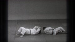 1971: karate masters illustrate avoidance moves in a dojo. TOKYO JAPAN Stock Footage