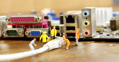 Close-up of figurine with cable and computer socket Stock Footage