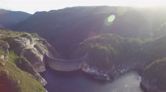 Round sweeping pan over Lake Gordon revealing the Gordon Dam,Tasmania Stock Footage