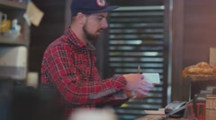 Barista Cashier communicates with the guests coffee Stock Footage