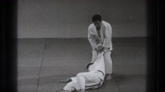 1971: man flipped onto back during martial arts event TOKYO JAPAN Stock Footage