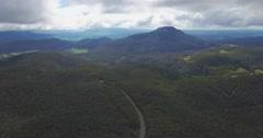 Backward flight above Highland Lakes Road in mountains, Tasmania, Australia Stock Footage
