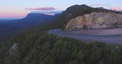 Sideways flight from road across forest in Mount Roland Regional Reserve Stock Footage