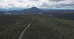 Forward flight above Highland Lakes Road in mountains, Tasmania, Australia Stock Footage